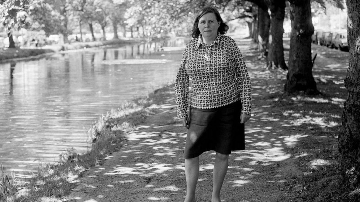 Katherine Kavanagh, the widow of Irish poet Patrick Kavanagh, ca.1978. Standing by the banks of the Grand Canal near Baggot Street Bridge, Dublin. © RTÉ Stills Library 2067/002