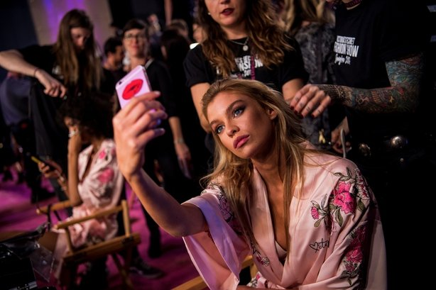 Stella Maxwell takes a selfie backstage before the start of the 2017 Victoria's Secret Fashion Show in Shanghai on November 20, 2017