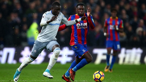 Oumar Niasse (L) in action against Crystal Palace