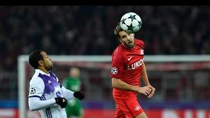 Maribor's Marcos Tavares and Spartak Moscow's Dmitry Kombarov vie for the ball