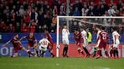 Guido Pizarro stabs home Sevilla's injury-time equaliser against Liverpool in Tuesday's Champions League clash