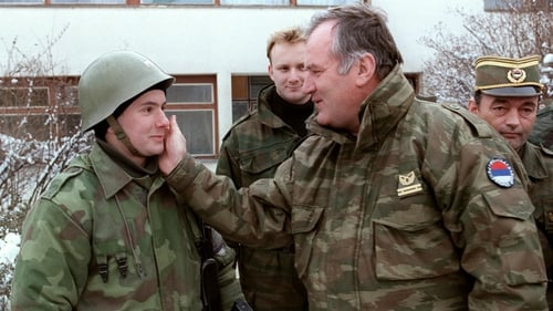 General Ratko Mladic speaks to a Serbian soldier in February 1994 on the outskirts of Sarajevo