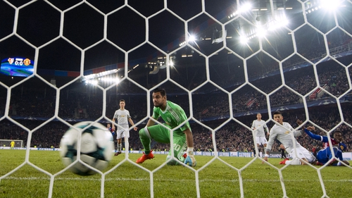 Sergio Romero watches the ball roll into the net