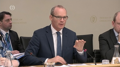 Minister Simon Coveney appearing before an Oireachtas Committee