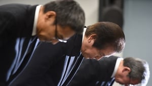Mitsubishi Materials boss Akira Takeuchi (middle) apologises for the scandal that could affect more than 250 of its customers