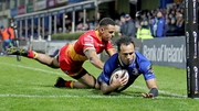 Isa Nacewa slides for a try in Leinster's 54-10 demolition of Dragons in the RDS
