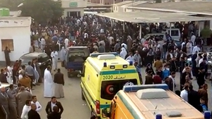 Crowds and ambulances outside the Al Rawdah mosque in Egypt's north Sinai