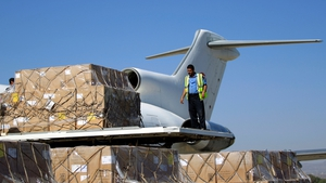 A cargo of vaccines is unloaded from a plane after it landed in Sanaa
