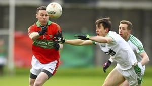 Former Wicklow star Leighton Glynn evades Mark Dempsey of Moorefield