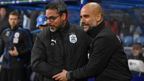 Manchester City defeat Huddersfield, set record