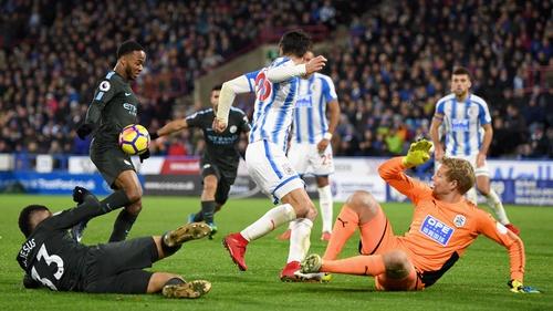 Raheem Sterling scores the winner for Manchester City via a rebound