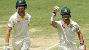 David Warner and Cameron Bancroft celebrate after winning the first Test