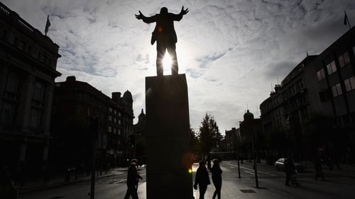 The sun shines through a statue of James Larkin on O'Connell Street in Dublin. Photo: Chris Jackson/Getty Images