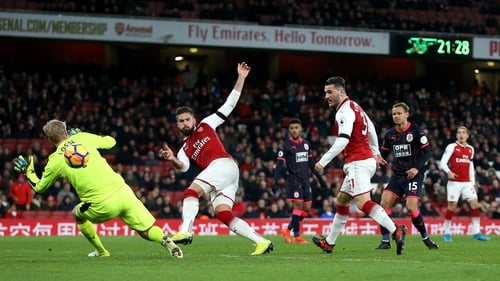 Olivier Giroud smashes home Arsenal's fourth in their demolition of Huddersfield