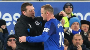 Unsworth greets Rooney after his hat-trick