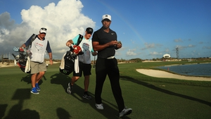 Tiger Woods was greeted on the 18th green by a Bahamas rainbow