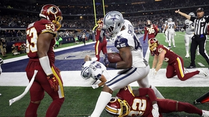 Rod Smith of the Dallas Cowboys runs the ball out of bounds