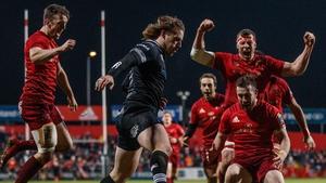 Munster's Darren Sweetnam, Robin Copeland and JJ Hanrahan celebrate Rory Scannell's try