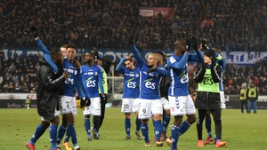 Strasbourg's players celebrate a famous victory