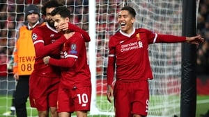 Mo Salah, Philippe Coutinho and Roberto Firmino celebrate at Anfield