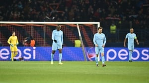 Manchester city's players walk on the pitch after conceding the first goal to Shakhtar