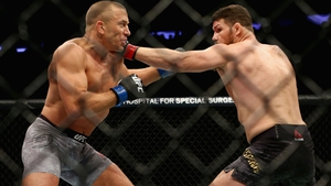 Georges St-Pierre beat Michael Bisping at UFC 217