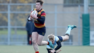 Lansdowne's Mark O'Keefe evades the challenge of Harry McNulty
