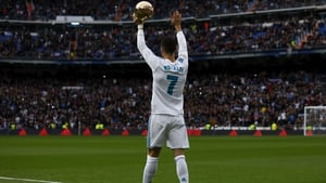 Ronaldo shows off his fifth Ballon d'Or trophy to fans within the Bernabeu prior to start the match between Real Madrid and Sevilla
