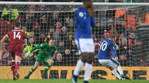 Wayne Rooney scores from the penalty spot