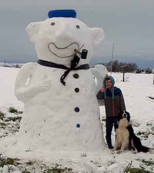 James Dunne, aged nine, with his dog Bailey enjoying the snow in Ballyfin, Co Laois (Pic: Rebecca Conroy)