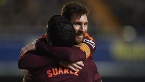 Lionel Messi and Luis Suarez celebrate a goal against Villarreal.