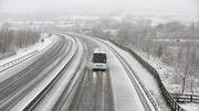 A coach drives through the snow on the M7 motorway in Co Limerick, near Birdhill