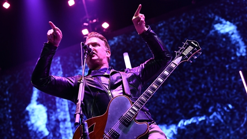 """Josh Homme onstage at the Forum in Inglewood, California on Saturday - """"I was a total d***, and I'm truly sorry"""""""