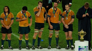 George Smith,Jeremy Paul, Justin Harrison, Matt Cockbain and Stirling Mortlock of the Wallabies stand dejected before the William Webb Ellis Trophy in 2003