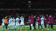 Manchester City players celebrate victory at Old Trafford