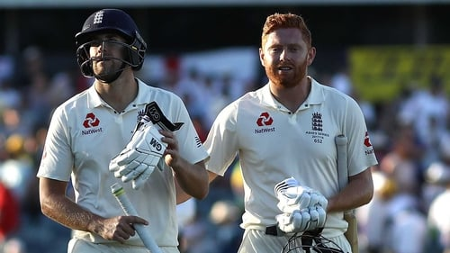 Dawid Malan (L) and Jonny Bairstow of England leave the ground at stumps on 110 not out