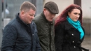 Britain First leader Paul Golding (L) and Jayda Fransen arriving at court in Belfast