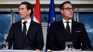 The leader of the Austrian Peoples Party (OeVP) Sebastian Kurz (L) and leader of the right-wing Austrian Freedom Party (FPOe) Heinz-Christian Strache (R) speak at a news conference in Vienna