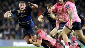Leinster's Tadhg Furlong tackled by Matt Kvesic of Exeter