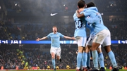 Manchester City players celebrate after Raheem Sterling scores their third goal