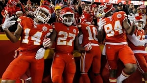 Running back Kareem Hunt (No 27) of the Kansas City Chiefs celebrates with teammates in the endzone after scoring a touchdown
