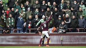 Kyle Lafferty celebrates in front of the Celtic fans after scoring Hearts' second