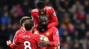 Romelu Lukaku is mobbed after his goal at West Brom