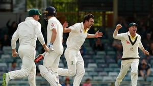 Pat Cummins of Australia celebrates the wicket of Chris Woakes