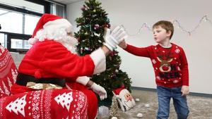 A high five for Santa. Photo: Aengus McMahon