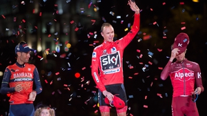 Britain's Chris Froome (c) of Team Sky celebrates on the podium with second placed Italy's Vincenzo Nibali (l)