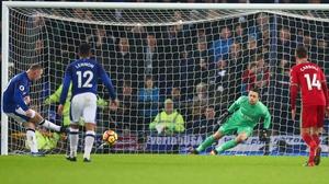 Lukasz Fabianski of Swansea City saves a penalty from Wayne Rooney