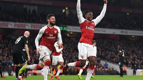 Danny Welbeck celebrates Arsenal's winner to move into the last four of the competition