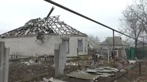 Home damaged by rocket fire in Novoluhanske in eastern Ukraine