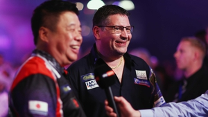 Paul Lim (L) with Gary Anderson